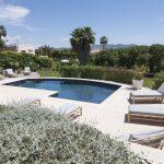 Sun loungers around the pool at Villa Gironella