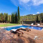 Pool and sundeck at Villa Santa Fe Sitges